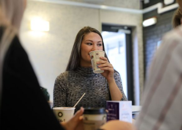 Student drinks coffee