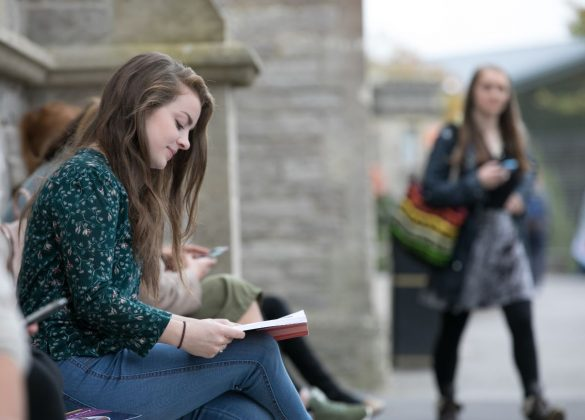 Student reads on campus